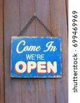 wooden label hang on the door | Shutterstock . vector #699469969