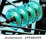 glass insulators on electric... | Shutterstock . vector #699486499