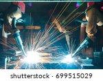 welding robots movement in a... | Shutterstock . vector #699515029