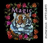 embroidery tiger and roses.... | Shutterstock .eps vector #699516895