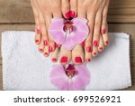 female feet red pedicure nails... | Shutterstock . vector #699526921
