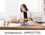 young business woman eating... | Shutterstock . vector #699527755