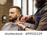 barber styling beard with... | Shutterstock . vector #699532129