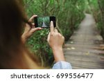 using phone taking photo in... | Shutterstock . vector #699556477