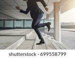 businessman running up the... | Shutterstock . vector #699558799