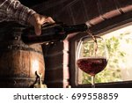 Sommelier Pouring Wine Into A...