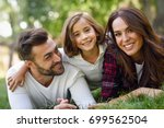 happy young family in a urban... | Shutterstock . vector #699562504