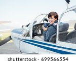 Smiling Female Pilot In The...