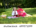 mother and daughter relax in... | Shutterstock . vector #699571099