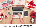 woman purchasing beauty and... | Shutterstock . vector #699572875