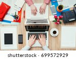 coworkers sharing the same desk ... | Shutterstock . vector #699572929