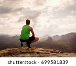 tourist in green singlet and... | Shutterstock . vector #699581839