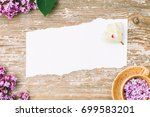 a piece of torn paper and a cup ... | Shutterstock . vector #699583201