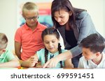 yong beautiful teacher with... | Shutterstock . vector #699591451