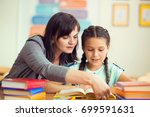 yong beautiful teacher with... | Shutterstock . vector #699591631