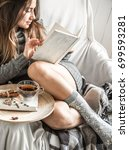 cute girl on a comfortable... | Shutterstock . vector #699593281