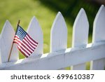 american flag on white picket... | Shutterstock . vector #699610387