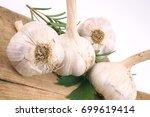 garlic and herbs | Shutterstock . vector #699619414