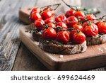 rye bread bruschetta with oven... | Shutterstock . vector #699624469