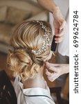 stylist makes hair the bride | Shutterstock . vector #699624784