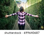 young woman walking in the park ... | Shutterstock . vector #699640687