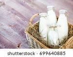 bottles of milk on a wooden... | Shutterstock . vector #699640885