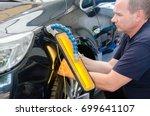 car mechanic in car service... | Shutterstock . vector #699641107