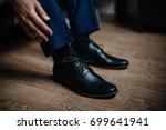 a man is wearing black shoes in ... | Shutterstock . vector #699641941