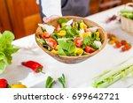 hands holding an healthy fresh... | Shutterstock . vector #699642721