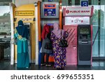 Small photo of Labuan,Malaysia-July 24,2017:People using the ATM (Automatic Teller Machine) to withdraw & transfer money at Labuan Financial Park Complex in Labuan island,Malaysia.