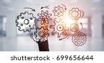 close of businesswoman hand... | Shutterstock . vector #699656644