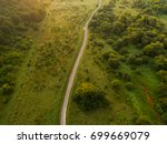 aerial view of twisting road... | Shutterstock . vector #699669079