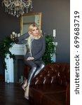 attractive blond girl in... | Shutterstock . vector #699683719