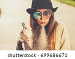 pretty young hipster woman in... | Shutterstock . vector #699686671