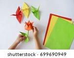 children's hands do origami... | Shutterstock . vector #699690949