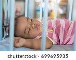 baby girl is sleeping in baby... | Shutterstock . vector #699695935