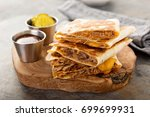 pulled pork quesadillas with... | Shutterstock . vector #699699931