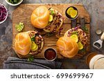 pulled pork sandwiches with bbq ... | Shutterstock . vector #699699967