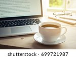 cup of hot coffee on wooden... | Shutterstock . vector #699721987