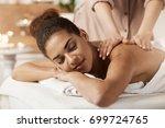 attractive african girl having... | Shutterstock . vector #699724765