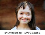 cute smiling down syndrome girl ... | Shutterstock . vector #699733051