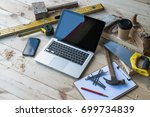 close up laptop on wooden... | Shutterstock . vector #699734839