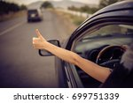 young happy young girl drives a ... | Shutterstock . vector #699751339