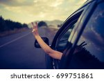 young happy young girl drives a ... | Shutterstock . vector #699751861