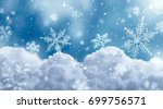 macro snowflake on snow and... | Shutterstock . vector #699756571