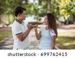 lovers in the park | Shutterstock . vector #699762415