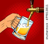 man pours beer into glass from... | Shutterstock .eps vector #699813811