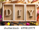 diy wood font style on a wooden ... | Shutterstock . vector #699813979