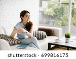 smiling young asia woman... | Shutterstock . vector #699816175