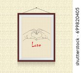 hand makes love photo frame on... | Shutterstock .eps vector #699820405